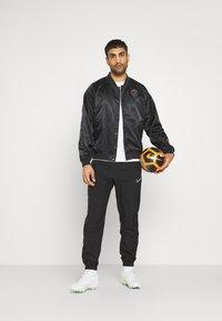 Nike Performance - JORDAN PARIS ST GERMAIN COACHES - Club wear - black/psychic purple - 1