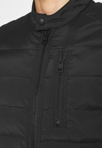 Calvin Klein Jeans - QUILTED PADDED MOTO JACKET - Light jacket - black - 4