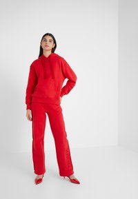 Escada Sport - TEHEART TROUSER - Tracksuit bottoms - red - 1