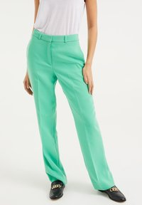 WE Fashion - Trousers - bright green - 0