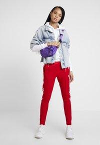 adidas Originals - Tracksuit bottoms - scarlet - 1