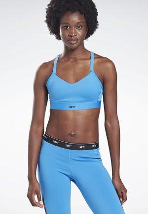 REEBOK HERO MEDIUM-IMPACT STRAPPY BRA - Sports bra - blue