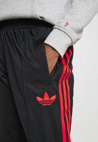 adidas Originals - SUPERSTAR 3STRIPES TRACK PANTS - Tracksuit bottoms - black/red - 4