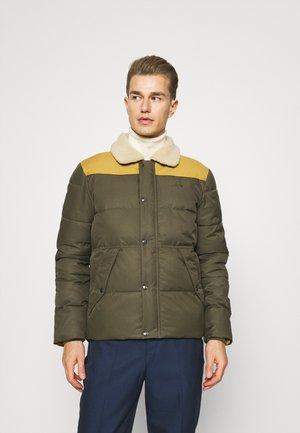HILLS - Winter jacket - forest/ochre