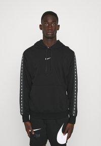 Nike Sportswear - REPEAT HOODIE - Sweatshirt - black/white - 0