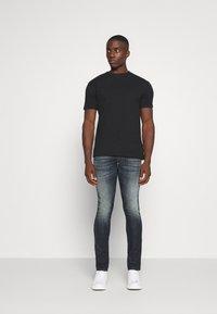 Diesel - THOMMER - Jeans slim fit - dark blue denim - 1
