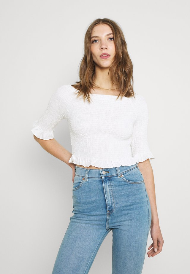 SMOCKED BARDOT WITH 1/2 SLEEVES AND FRILL HEMS - Print T-shirt - off white