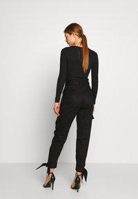 NA-KD - Erica Kvam x NA-KD - Pantalones - black - 2