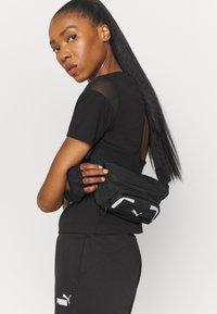 Puma - PAMELA REIF X PUM TEE BACK CUTOUT - Print T-shirt - black - 3