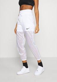 Nike Sportswear - INDIO PANT - Verryttelyhousut - white/black - 0