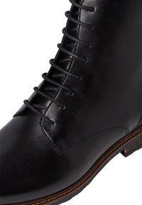 Tamaris - Lace-up ankle boots - black - 6