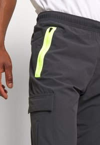 Nike Sportswear - FESTIVAL - Tracksuit bottoms - smoke grey/volt - 3