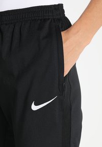 Nike Performance - DRY PANT  - Tracksuit bottoms - black/black/white - 5