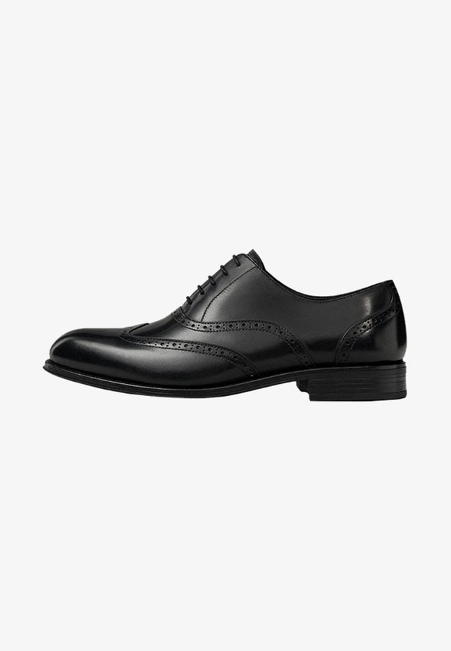 MIT BROGUING  - Eleganckie buty - black