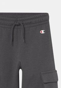 Champion - AMERICAN CLASSICS CUFF PANTS UNISEX - Pantalon de survêtement - dark grey - 2