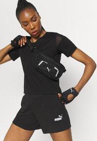 Puma - PAMELA REIF X PUM TEE BACK CUTOUT - Print T-shirt - black - 4