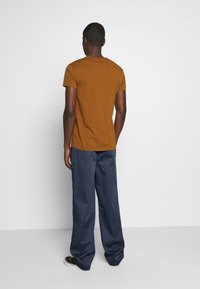 Dickies - CLARKSTON - Trousers - blue
