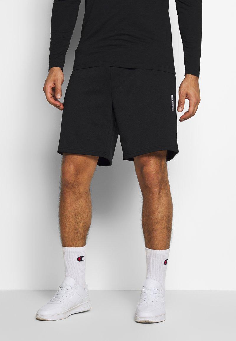 Jack & Jones - JJIZPOLYESTER SHORT - Sports shorts - black
