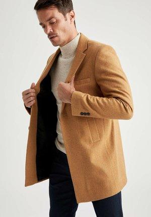 Halflange jas - brown