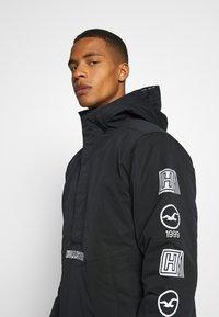 Hollister Co. - ANORAK - Light jacket - black - 3
