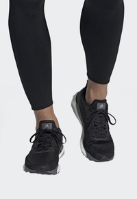 adidas Performance - SOLARBOOST 19 SHOES - Stabilty running shoes - black - 0
