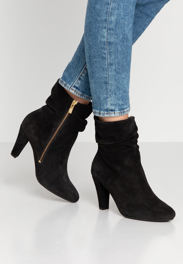 RITA - Classic ankle boots - black