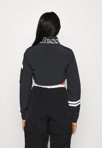 Ellesse - LAUDE CROP TRACK  - Summer jacket - black - 2