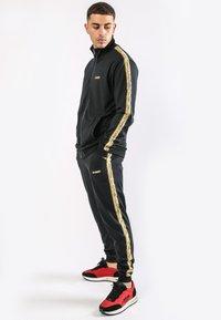 Ed Hardy - CHEETAH-CRYSTAL TRICOT HOTFIX TRACKTOP - Training jacket - black - 2