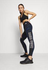 adidas Performance - GRAPHIC - Leggings - black - 1