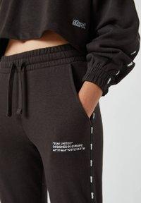 PULL&BEAR - Pantaloni sportivi - black - 4