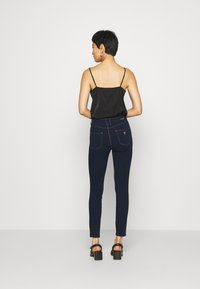 Guess - EXPOSED BUTTON - Jeans Skinny Fit - dark-blue denim - 2
