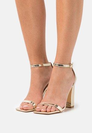 High heeled sandals - gold mirror