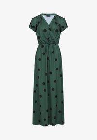 black polka dots on green