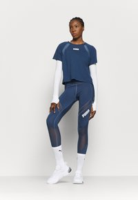 Puma - PAMELA REIF X PUMA COLLECTION RUSHING - Sports shirt - star white - 1