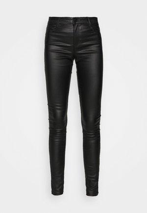 COATED FRANKIE - Pantalones - black