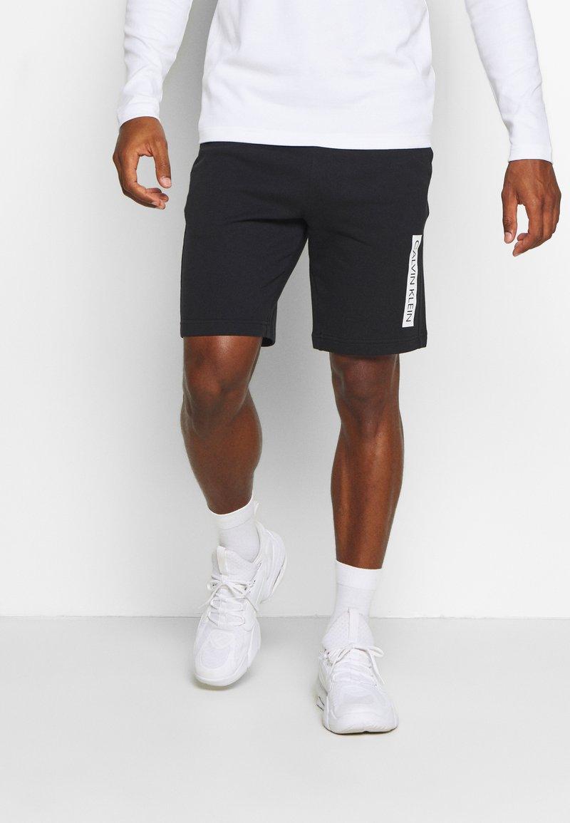 Calvin Klein Performance - SHORT - Sports shorts - black