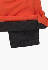 Gosoaky - BIG BAD WOLF UNISEX - Snow pants - spicy red - 3