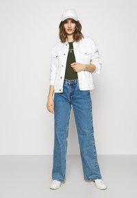 Calvin Klein Jeans - ROUND TEE - Print T-shirt - deep depths - 1