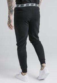 SIKSILK - EXHIBIT FUNCTION PANTS - Pantalones deportivos - black - 2