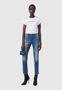 Diesel - BABHILA  - Slim fit jeans - medium blue - 1