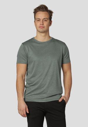 T-shirt med print - agave green