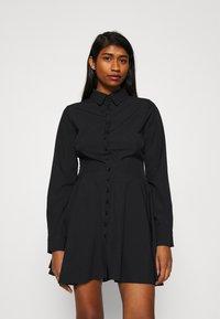 Missguided - BUTTON DOWN SKATER DRESS - Shirt dress - black - 0