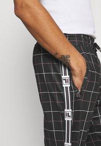 Fila - WAITE TRACK PANT - Tracksuit bottoms - black - 4