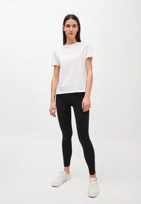 ARMEDANGELS - SHIVA - Leggings - Trousers - black - 1