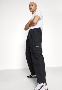 adidas Originals - CARGO PANT UNISEX - Cargobyxor - black - 5