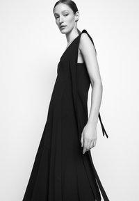 Victoria Beckham - DOUBLE FLARE MIDI - Cocktail dress / Party dress - black - 4