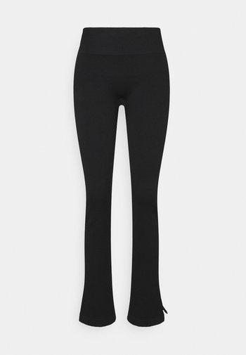 SEAMLESS SLIT PANTS - Pantaloni sportivi - black