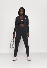 adidas Performance - ENERGIZE - Tracksuit - black/white - 1