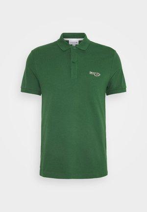 Koszulka polo - vert