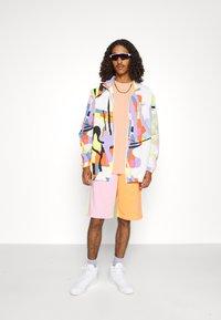 adidas Originals - UNISEX LOVE UNITES - Summer jacket - multicolor - 4